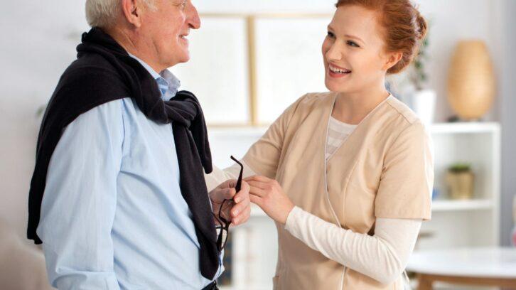 Male senior with female caregiver