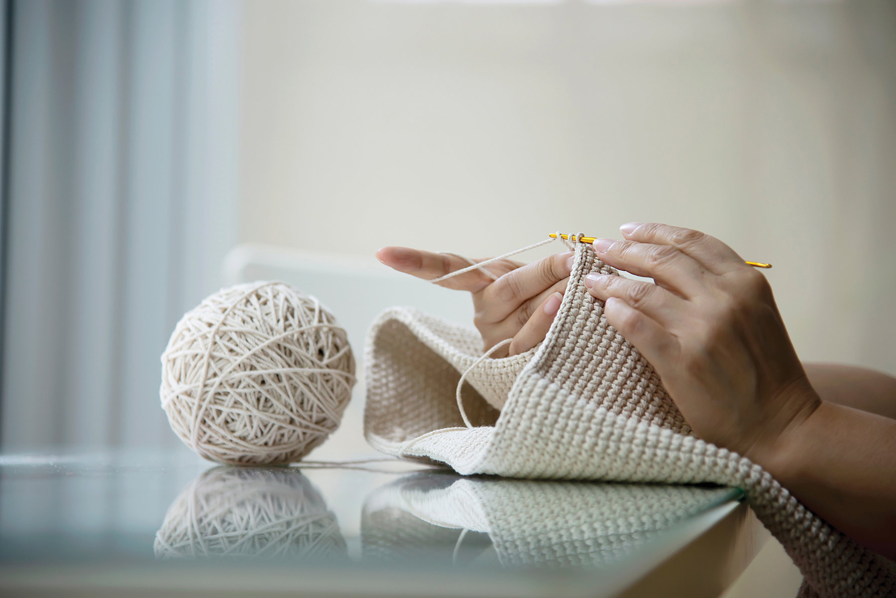 Woman's hands doing home knitting work