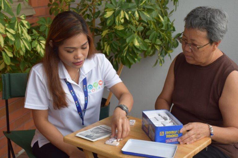 Mosaic home care nurse socializing with senior