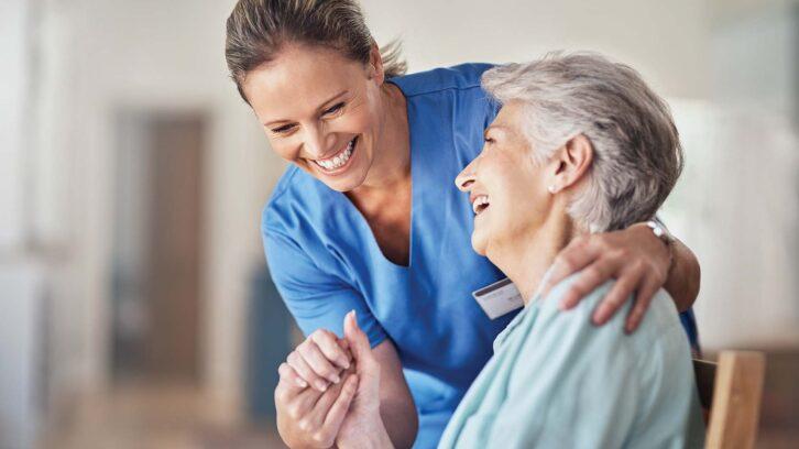 Nurse consultant with senior patient