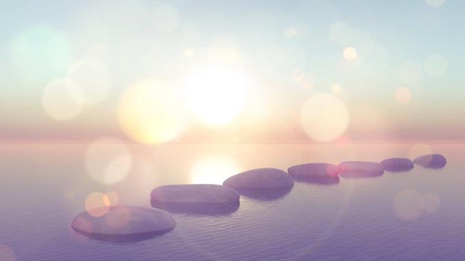 Sun shining on stones on the beach