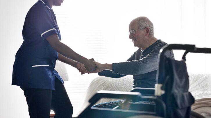 Nurse helping senior in wheelchair
